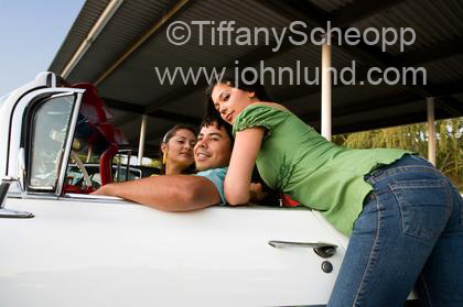 Two Hispanic Chicks A Convertible And A Dude Enjoying Their Car